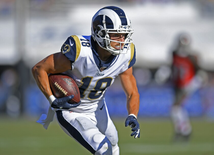 Rams wide receiver Cooper Kupp runs with the ball against the Tampa Bay Buccaneers on Sunday.