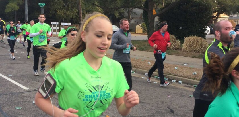 Cameron Gallagher as she ran in her last race. She passed away unexpectedly moments after crossing the finish line because of an undiagnosed heart arrhythmia.