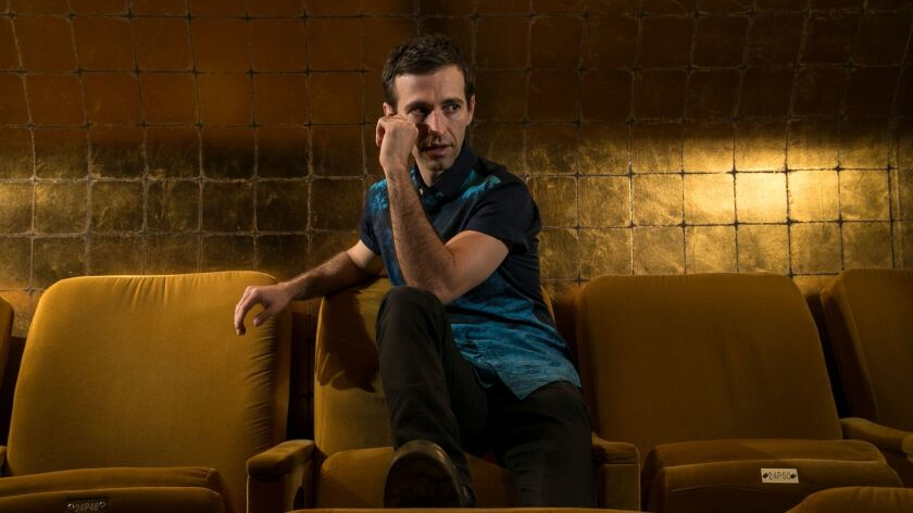 """Anthony Roth Costanzo, who sings the title role of L.A. Opera's production of Philip Glass' """"Akhnaten,"""" inside the Dorothy Chandler Pavilion."""