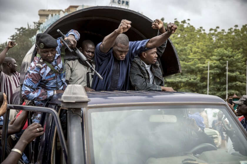 Security forces and others drive in celebration through Bamako, Mali's capital.