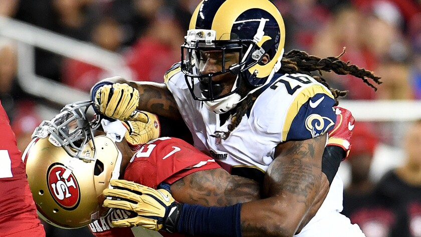 """Says linebacker Mark Barron, shown leveling 49ers running back Shaun Draughn, of the Rams' season finale Sunday: """"We're still taking pride in this thing."""""""