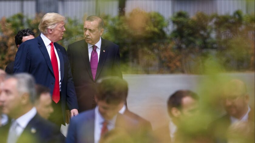 President Trump and Turkish President Recep Tayyip Erdogan at the opening ceremony of the NATO summit in Brussels on July 11.