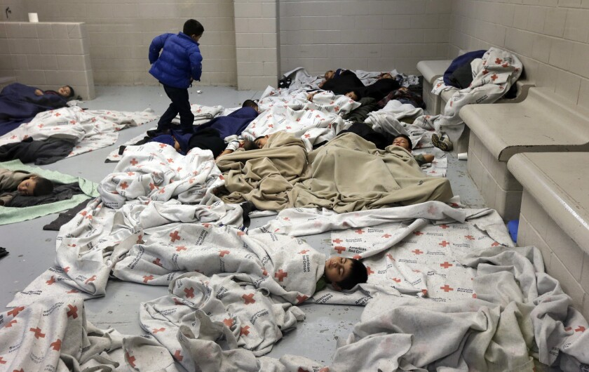 Detainees sleep in a holding cell at a U.S. Customs and Border Protection facility in Brownsville, Texas.