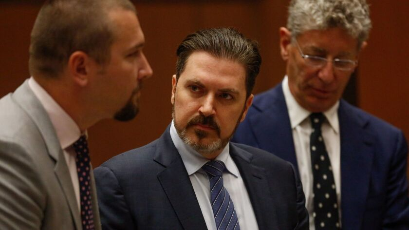 Pasquale Rotella, center, pictured in 2016, is chief executive of Insomniac. The rave promoter has agreed to settle a civil lawsuit filed by the Los Angeles Memorial Coliseum Commission, resulting in a payment of $3.5 million to the government agency.