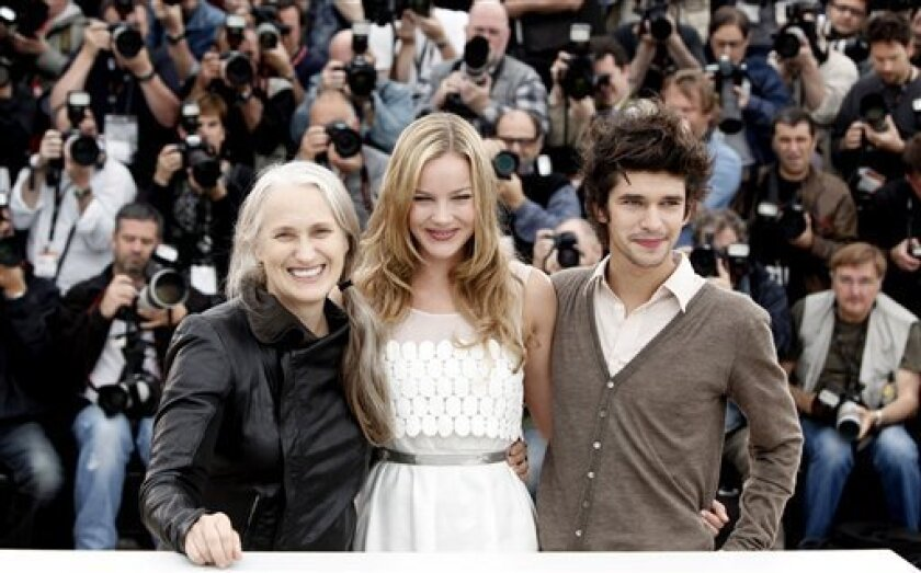New Zealand director Jane Campion, Australian actress Abbie Cornish and British actor Ben Whishaw during a photocall for the film 'Bright Star' during the 62nd International film festival in Cannes, southern France, Friday, May 15, 2009. (AP Photo/Matt Sayles)