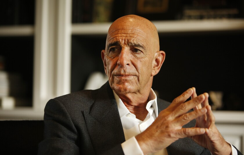 Thomas Barrack sits with fingertips resting together