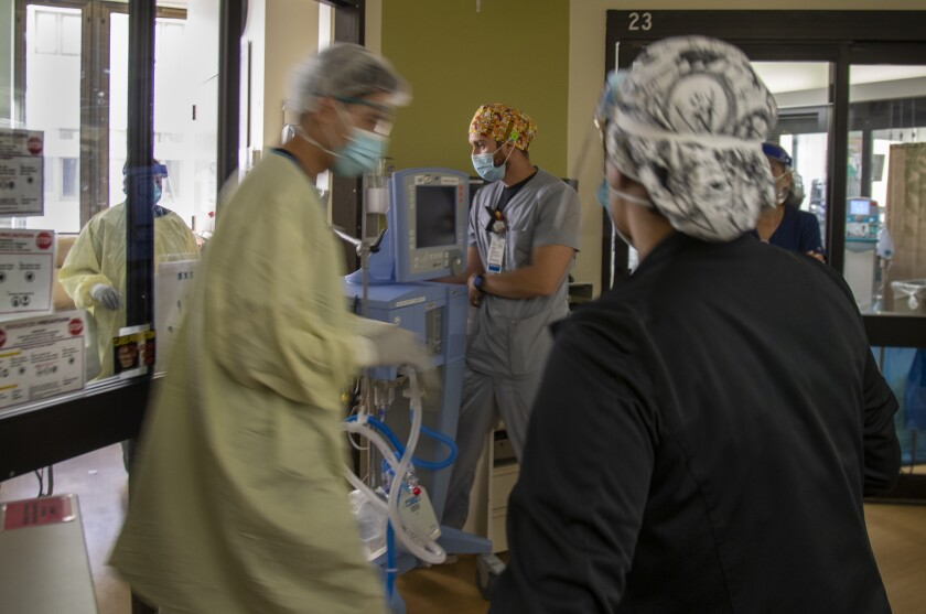 An ICU team prepares to intubate a COVID-19 patient at Loma Linda University Medical Center in San Bernardino County