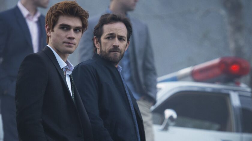 "Luke Perry, right, with his TV son played by KJ Apa in the CW's ""Riverdale."""