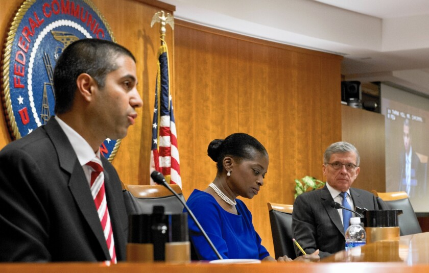 """""""Litigants are already lawyering up to seek judicial review of these new rules,"""" said FCC Commissioner Ajit Pai, left. With him are Commissioner Mignon Clyburn, center, and Chairman Tom Wheeler."""