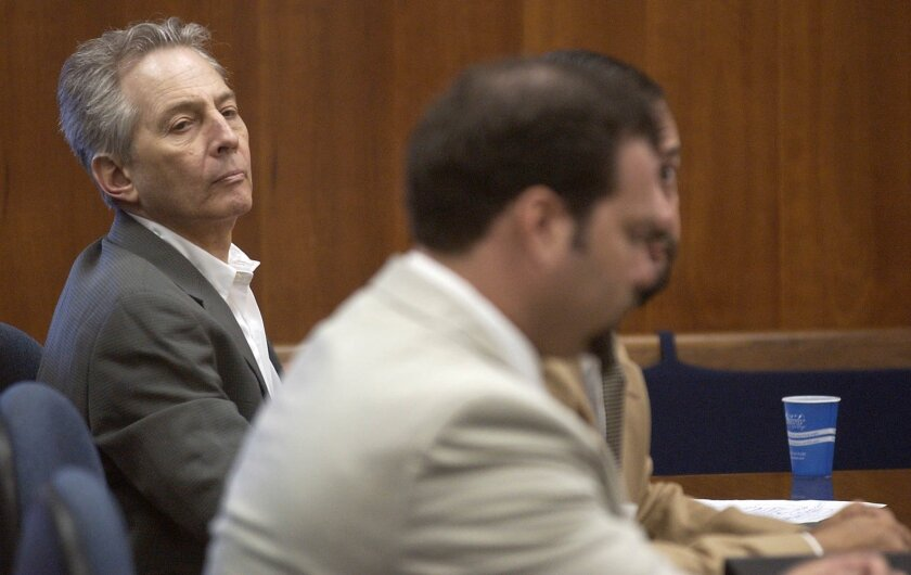 In this Aug. 18, 2003, file photo, Robert Durst, left, sits in a courtroom during a pretrial hearing at the Galveston County Courthouse in Galveston, Texas.