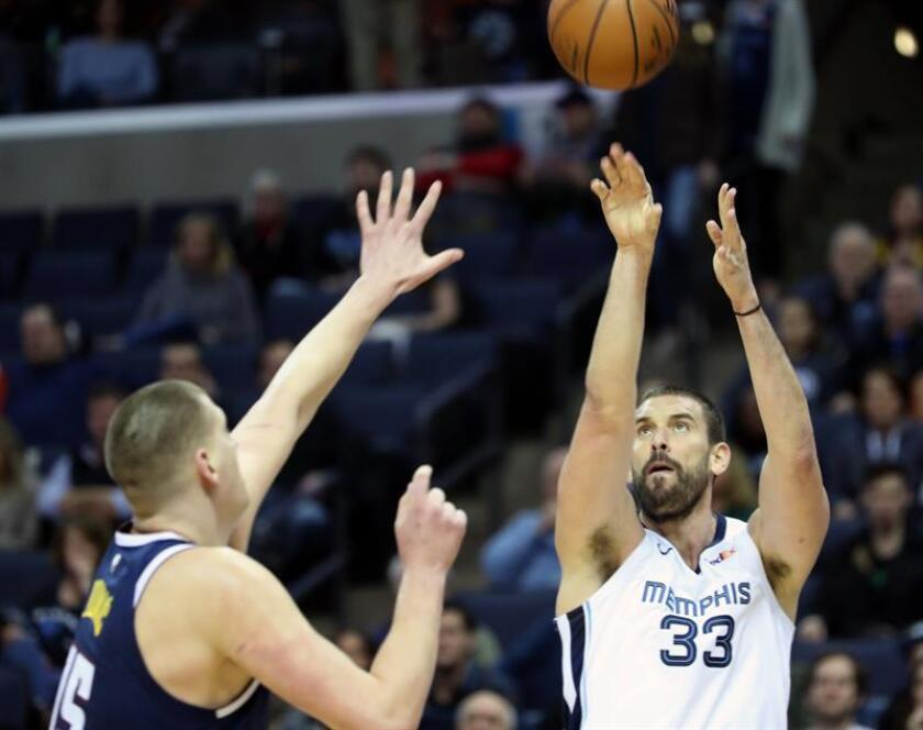 The Memphis Grizzlies' Marc Gasol (right) in action against the Denver Nuggets' Mason Plumlee during an NBA game on Jan. 28, 2019, at the FedEx Forum in Memphis, Tennesse. EPA-EFE/Karen Pulfer Focht