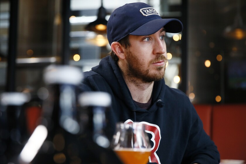 In this March 9, 2020, photo, Philadelphia Flyers' Kevin Hayes speaks during an interview with The Associated Press at Yards Brewing Company, in Philadelphia. Hayes' addition has been a big part of the Flyers success, his popularity soaring to the point there's now a Big Hayes-y IPA on tap at Yards Brewery. (AP Photo/Matt Slocum)