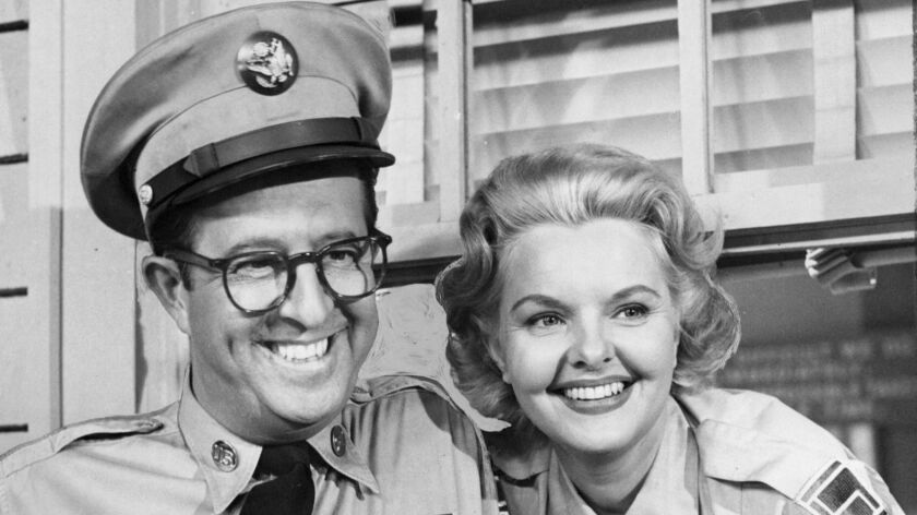 "Phil Silvers and Elisabeth Fraser in the TV show ""The Phil Silvers Show."""