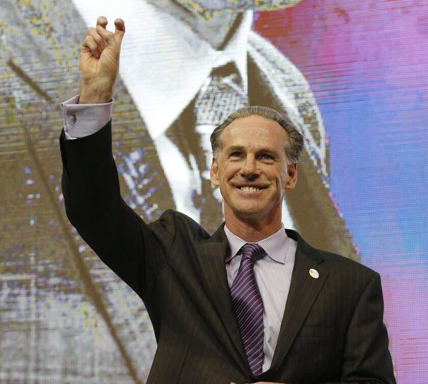 TCU's new men's basketball coach Jamie Dixon gestures with the horned frog hand sign after he was introduced during an NCAA college basketball news conference, Tuesday, March 22, 2016, in Fort Worth, Texas. Dixon, who left Pittsburgh after leading the Panthers to 11 NCAA Tournaments in 13 seasons, six-year contract with his alma mater. (Ron T. Ennis/Star-Telegram via AP) MAGS OUT; (FORT WORTH WEEKLY, 360 WEST); INTERNET OUT; MANDATORY CREDIT