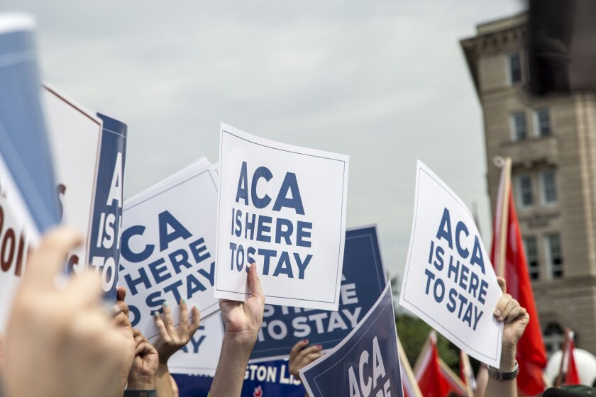 Supporters of the Affordable Care Act rally at the U.S. Supreme Court on June 25 in Washington, D.C.