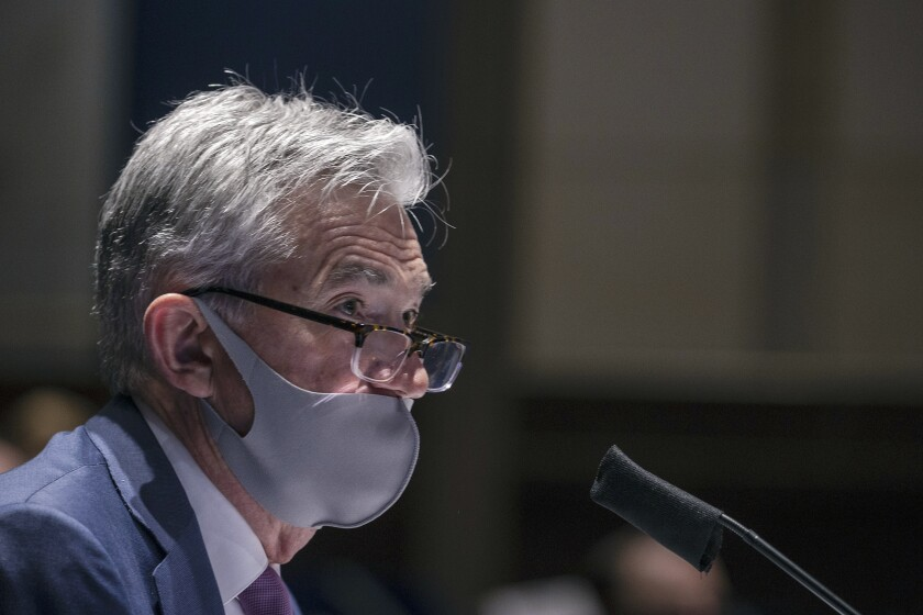 Federal Reserve Board Chairman Jerome Powell wears a mask while testifying before a House committee hearing