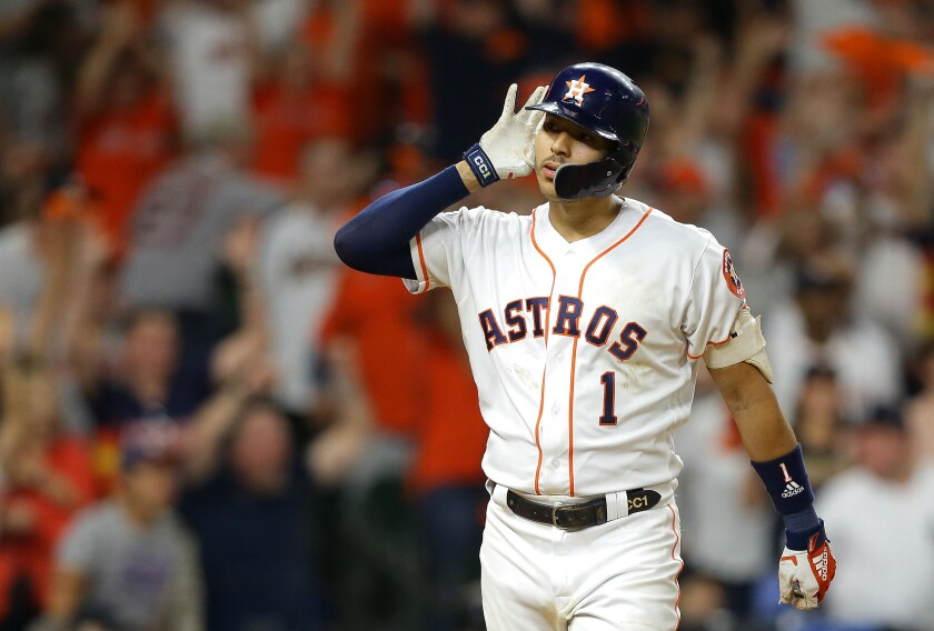 Houston's Carlos Correa celebrates after hitting a walk-off solo home run during the eleventh inning against the New York Yankees on Sunday in Game 2 of the ALCS.