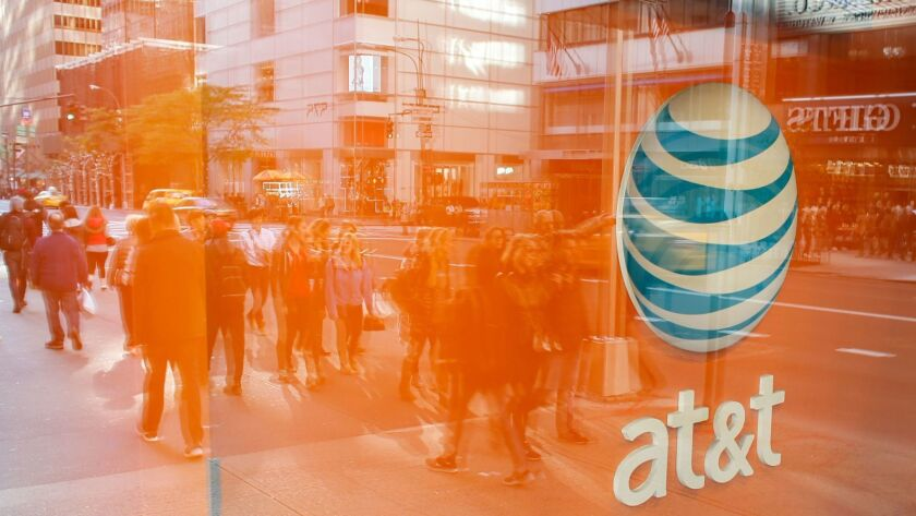 A federal judge will decide Tuesday whether to allow AT&T to buy Time Warner Inc., owner of CNN, HBO and Warner Bros.