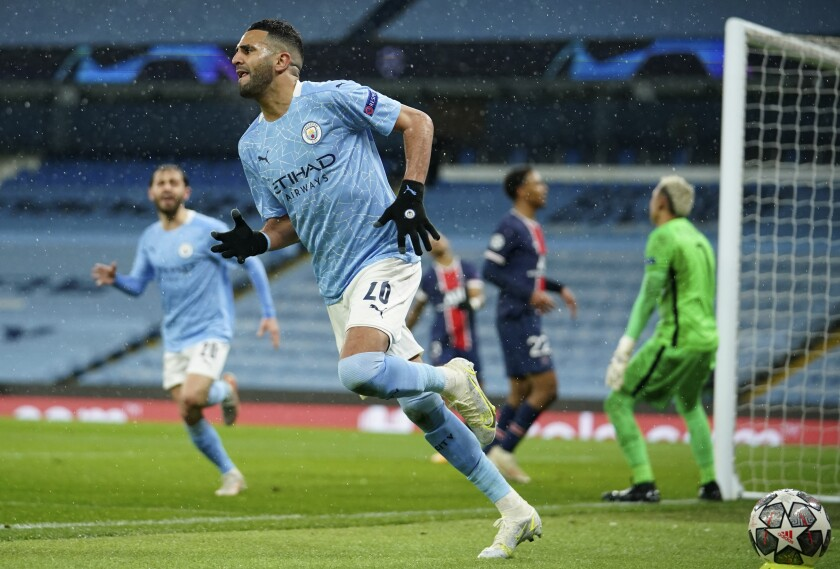 Manchester City's Riyad Mahrez celebrates after scoring his sides second goal during the Champions League semifinal second leg soccer match between Manchester City and Paris Saint Germain at the Etihad stadium, in Manchester, Tuesday, May 4, 2021. (AP Photo/Dave Thompson)