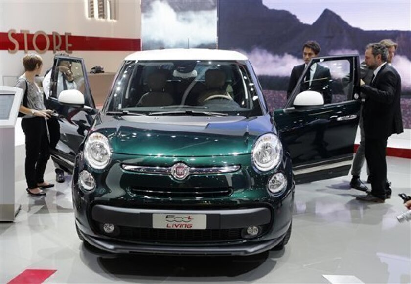 Visitors take a look a the Fiat 500 Living during the first press day of the 65th Frankfurt Auto Show in Frankfurt, Germany, Tuesday, Sept. 10, 2013. More than 1,000 exhibitors will show their products to the public from Sept. 12 through Sept.22, 2013. (AP Photo/Michael Probst)