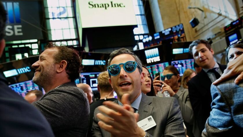 Wearing spectacles by Snap Inc., Chris Taylor, a vice president of the New York Stock Exchange, celebrates the company's stock listing.