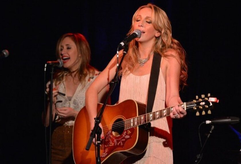 """Ashley Monroe, right, with singer/songwriter Jessi Alexander during the Nashville release party for """"Like a Rose"""" earlier this month."""
