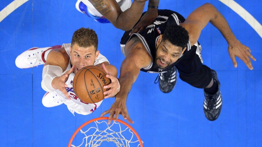 Clippers forward Blake Griffin, left, grabs a rebound in front of San Antonio Spurs forward Tim Duncan during the Clippers' loss in Game 5 of the Western Conference quarterfinals at Staples Center on April 28.