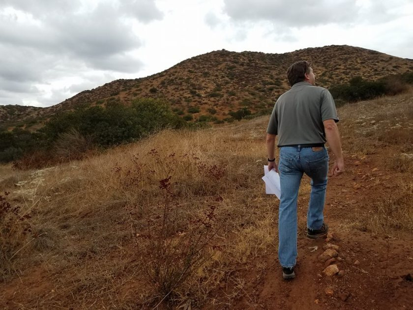 HomeFed Corp. Director of Operations Jeff O'Connor walks along part of Fanita Ranch on the land his company owns in Santee in this 2017 photo. Three environmental groups have filed a lawsuit in Superior Court against the city for its climate action plan which it says gives a free pass to the proposed nearly 3,000-home development in Santee.