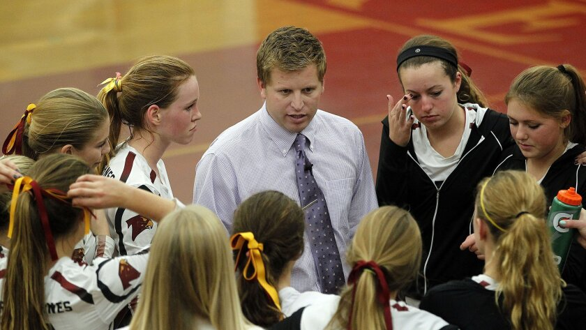 Torrey Pines girls volleyball coach Brennan Dean provides some encouragement to his players during a break in the Falcons' three-game home loss to Redondo Union in the Division I state playoffs.