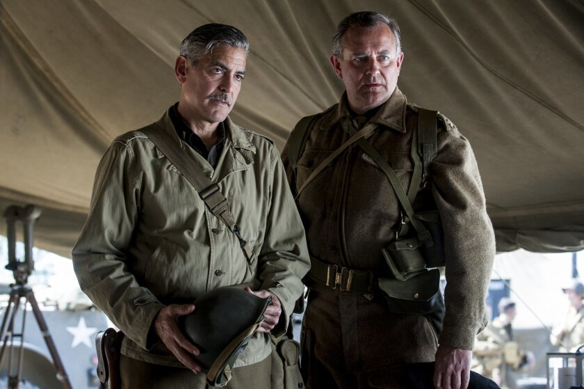 """This image released by Columbia Pictures shows George Clooney, left, and Hugh Bonneville in """"The Monuments Men."""" (AP Photo/Columbia Pictures, Claudette Barius)"""