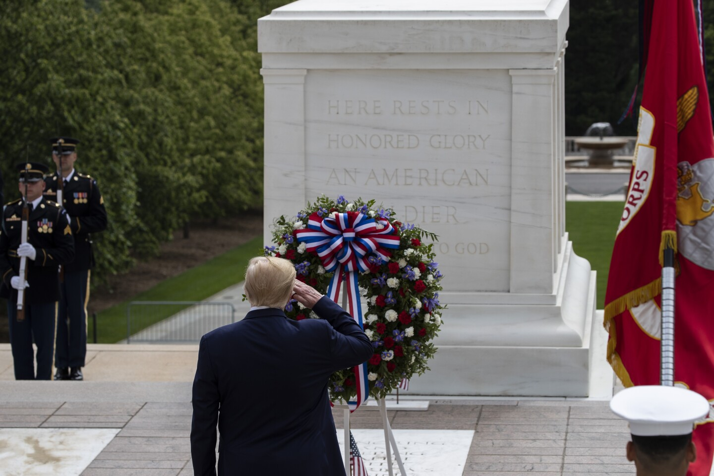 President Donald Trump salutes after placing a wreath at the Tomb of the Unknown Soldier in Arlington National Cemetery, in honor of Memorial Day, Monday, May 25, 2020, in Arlington, Va. (AP Photo/Alex Brandon)