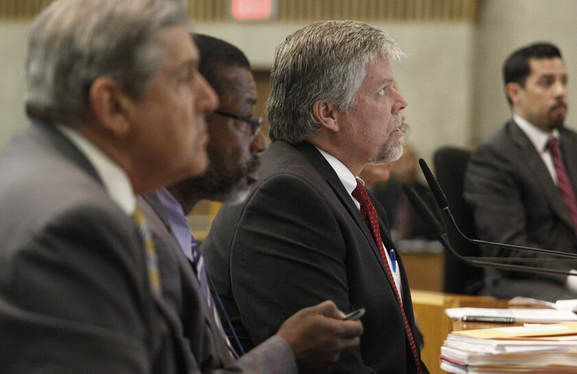 Jerry Powers, center, chief probation officer for Los Angeles County, addresses the County Board of Supervisors on Aug. 20, 2013. Powers is pushing back against a proposal to shift millions of dollars in state money from his department to a new Office of Diversion and Reentry.