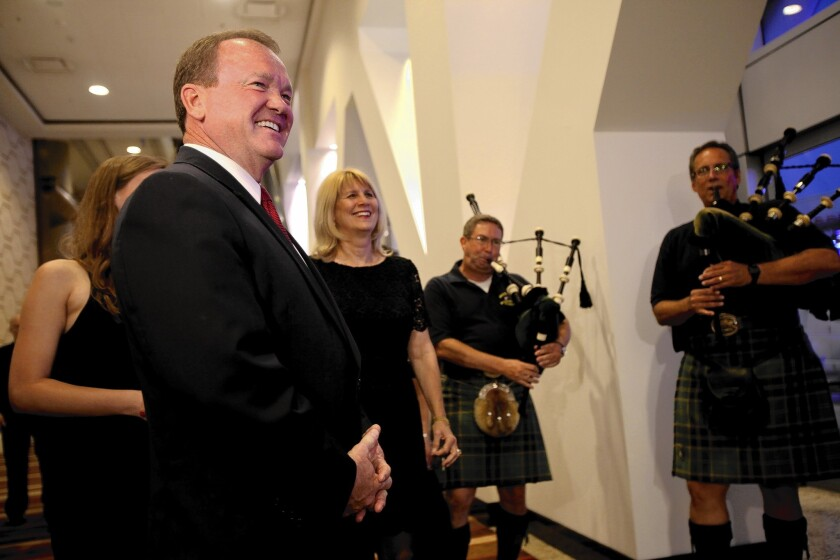 Bagpipers greet L.A. County sheriff's candidate Jim McDonnell at his election party. McDonnell was leading six other candidates in early voting results.