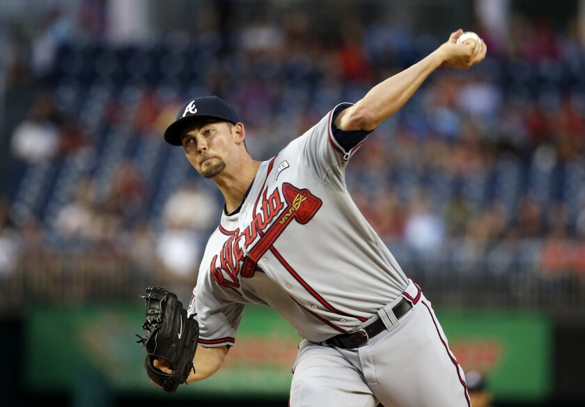 FILE - In this Sept. 8, 2014, file photo, Atlanta Braves starting pitcher Mike Minor throws during the first inning of a baseball game against the Washington National in Washington. Minor agreed Friday, Feb. 19, 2016, to a $7.25 million, one-year contract with the Kansas City Royals, a deal that could be worth $24.5 million over three seasons if he is a regular member of the rotation. (AP Photo/Alex Brandon, File)