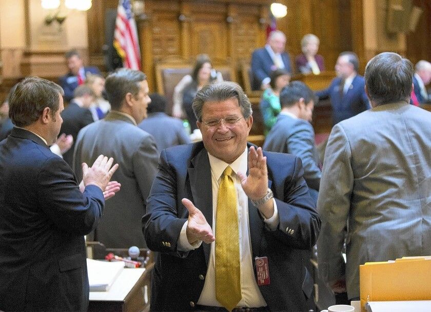 Georgia state Rep. Alan Powell celebrates after a gun bill passed in the House this month. Gov. Nathan Deal is expected to sign it into law.