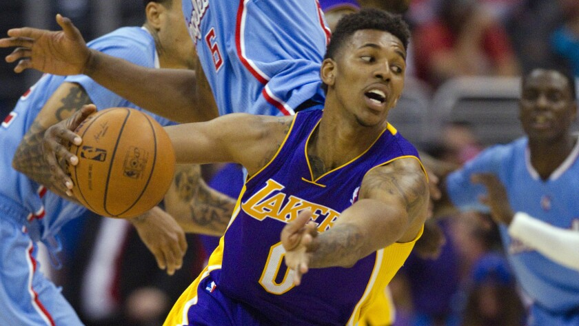 Lakers guard-forward Nick Young underwent surgery to repair a torn ligament in his right thumb.