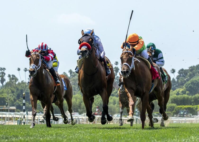 Horses race at Santa Anita Park.