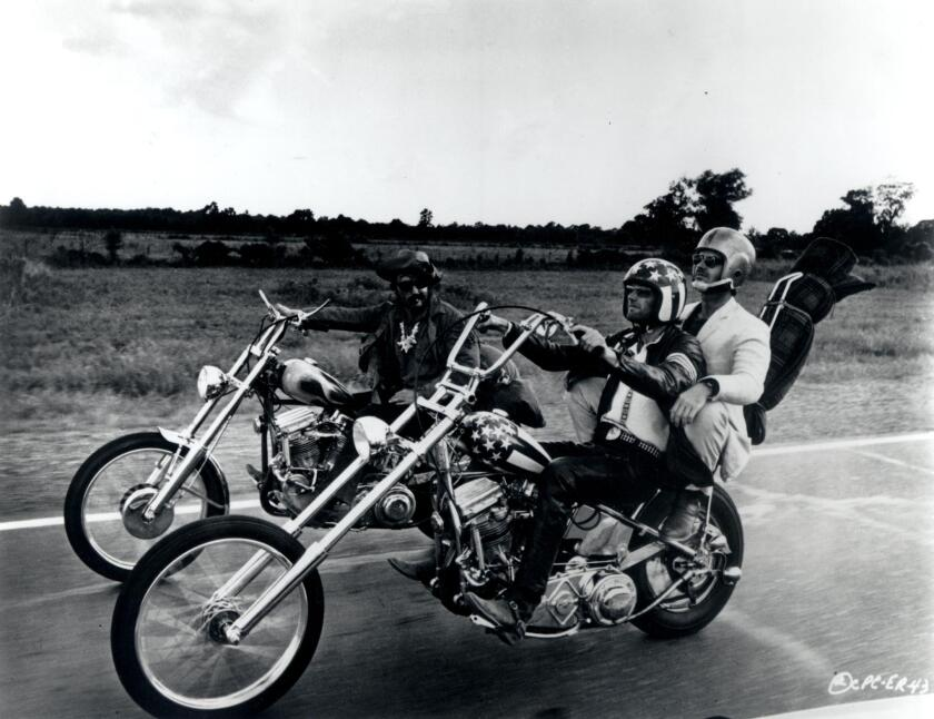 """Dennis Hopper, Peter Fonda and Jack Nicholson ride choppers designed by Vaughs and fellow African American bike builder Ben Hardy in """"Easy Rider."""""""
