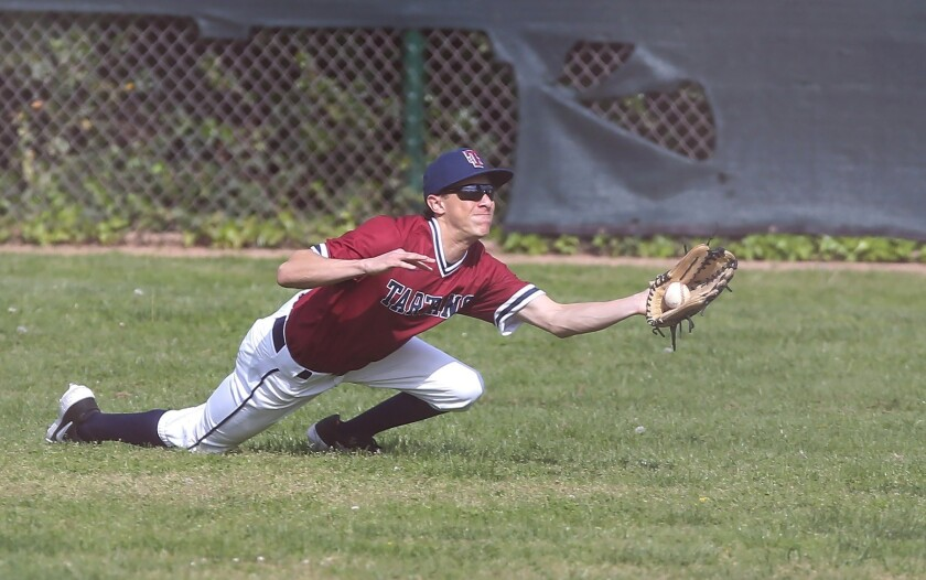 St. Margaret's right fielder Solomon Banks makes diving catch of a pop fly during a San Joaquin Leag