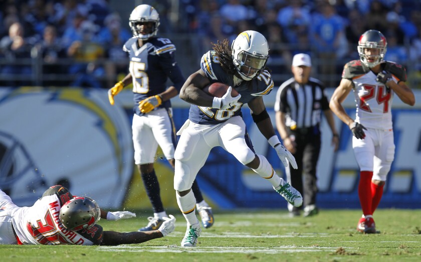 Chargers running back Melvin Gordon runs for a first down in the first quarter against the Tampa Bay Buccaneers at Qualcomm Stadium on Dec. 4, 2016. (Photo by K.C. Alfred/San Diego Union-Tribune)