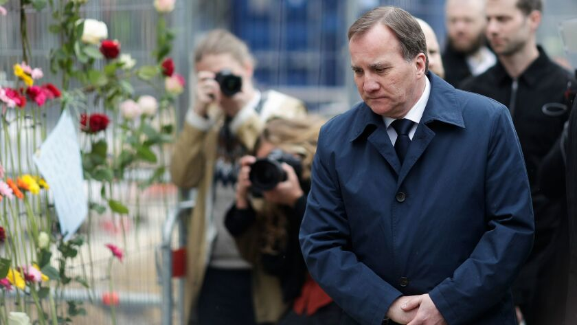 Sweden's Prime Minister Stefan Lofven visits the site of the attack in Stockholm.