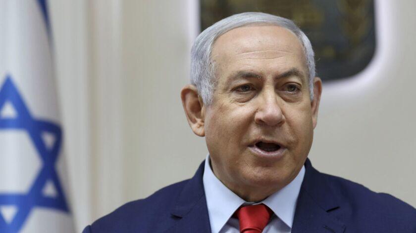 Israel's Prime Minister Benjamin Netanyahu speaks during the weekly cabinet meeting at his Jerusalem