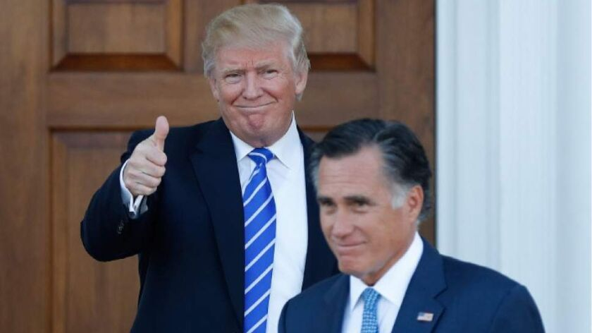 Donald Trump gestures after meeting with Mitt Romney on Nov. 19 at the Trump National Golf Club Bedminster in Bedminster, New Jersey.