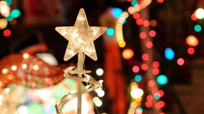 Christmas Lights Background. Nativity star, blurred lights and outdoor decorations