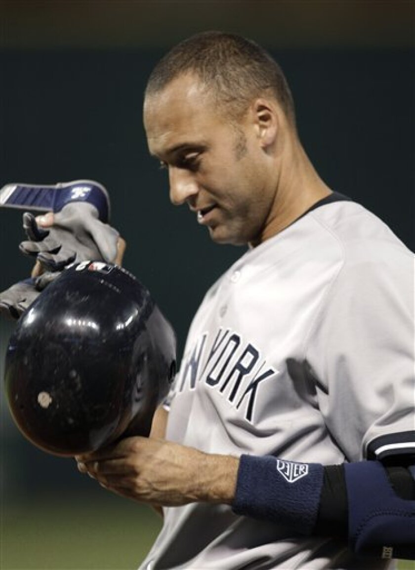 New York Yankees' Derek Jeter takes off his batting gloves and helmet after grounding out in the seventh inning in a baseball game against the Cleveland Indians, Tuesday, July 5, 2011, in Cleveland. (AP Photo/Tony Dejak)