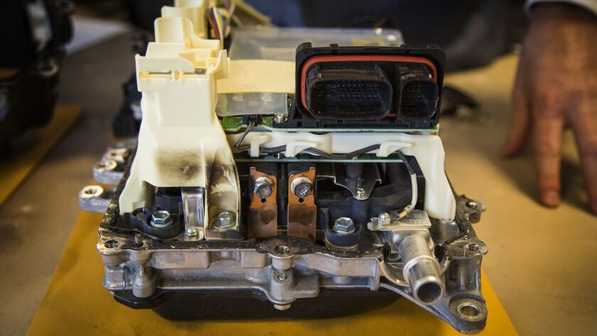This defective power inverter came out of a 2012 Prius. The car lost power in January while being driven in San Juan Capistrano, Calif. The burn marks show how the inverter overheated and melted components.