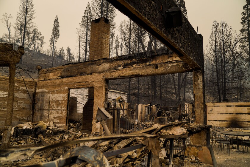 The smoldering remains of Cressman's General Store and Gas Station along CA-168.