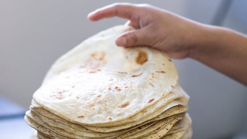 Sonoratown tortillera Julia Guerrero stacks freshly pressed tortillas