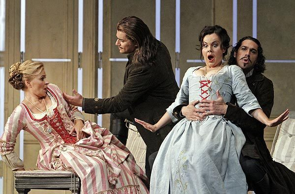 "Ruxandra Donose, left, Saimir Pirgu, Aleksandra Kurzak and Ildebrando D'Arcangelo in L.A . Opera's production of Mozart's ""Cosi fan Tutte."""
