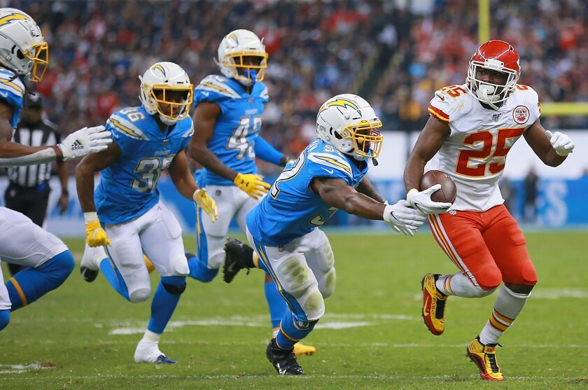 The Chargers' Denzel Perryman (52) pursues Chiefs running back LeSean McCoy during their game in Mexico City.